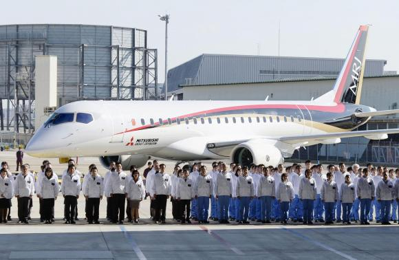 A Mitsubishi Regional Jet (MRJ) is unveiled at the hanger at Mitsubishi Heavy Industries' Nagoya Aerospace Systems Works Komaki Minami Plant in Toyoyama town, Nagoya prefecture